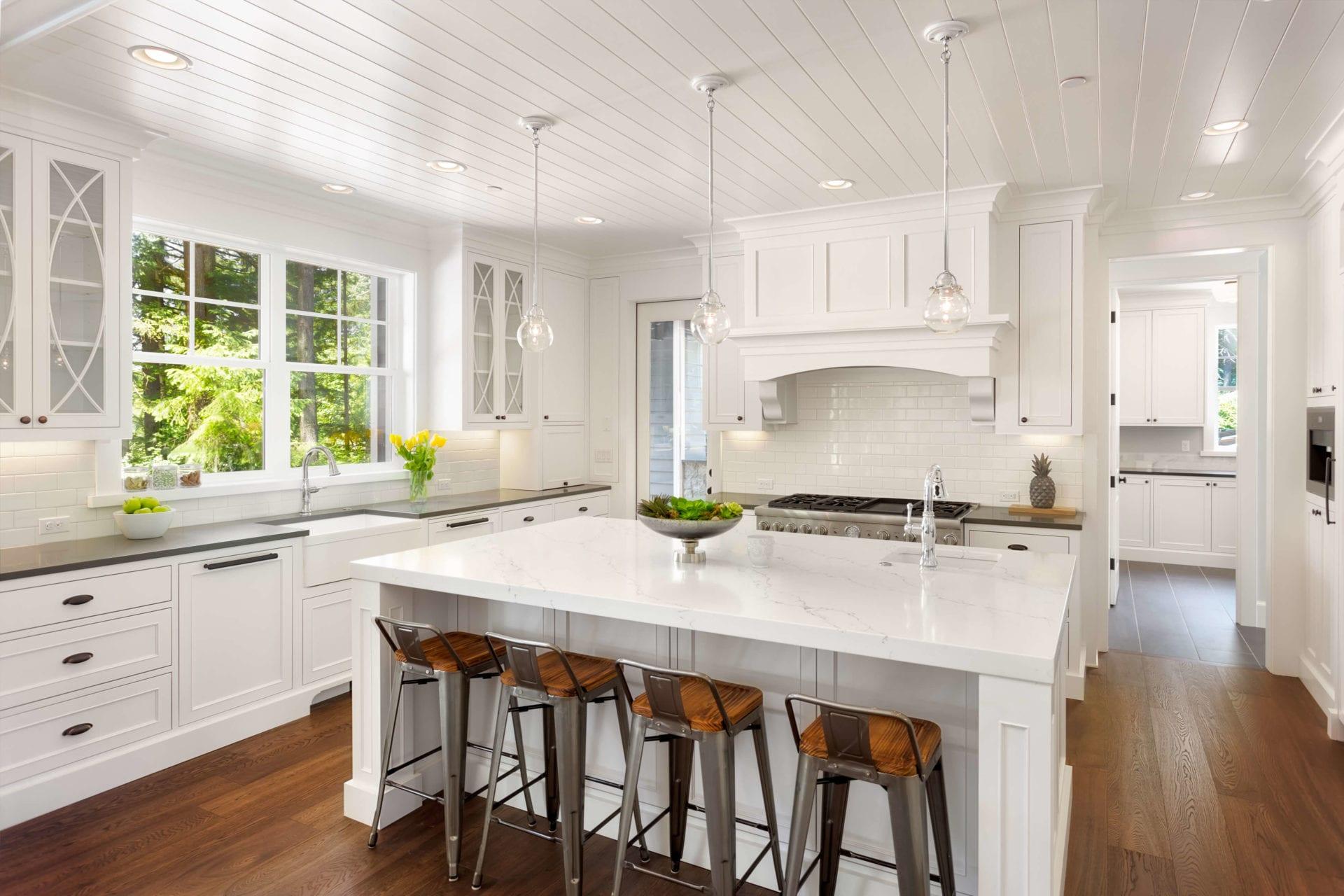 Clean white marble white cabinet kitchen in organized home Redondo beach southern California