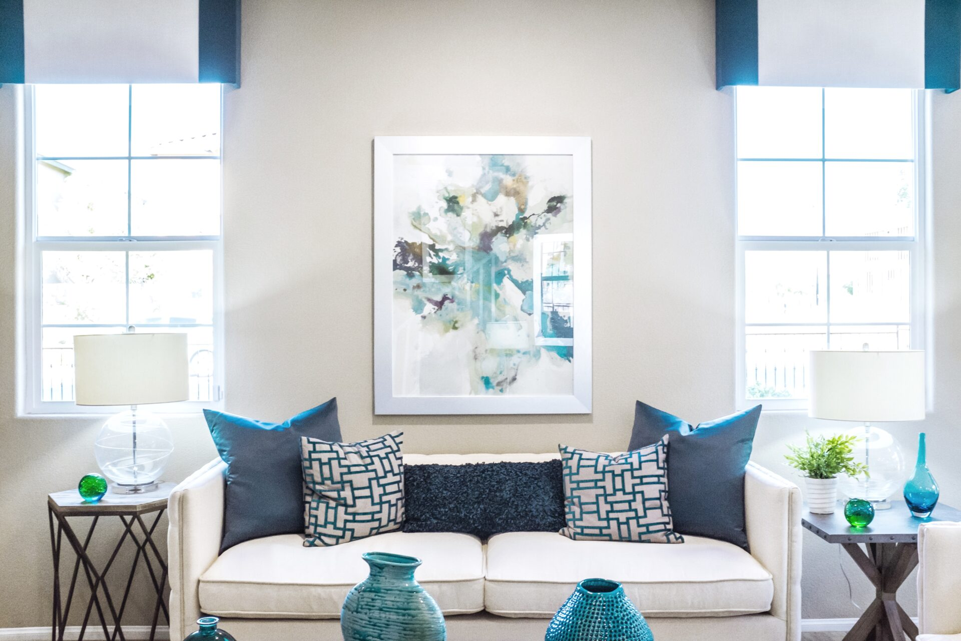 blue and white themed living room tidy and clean with bright lighting