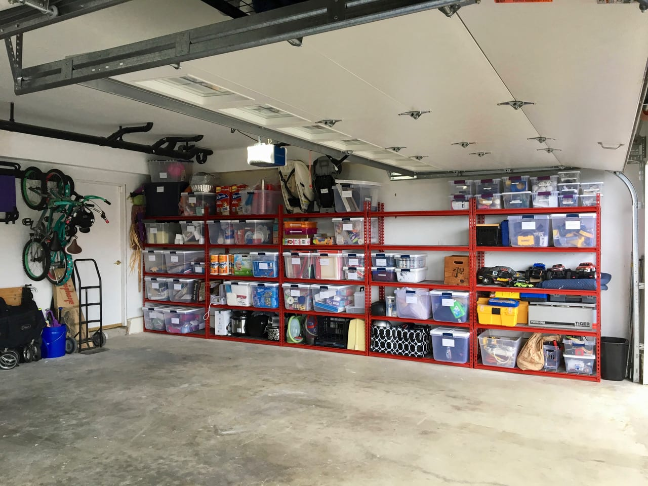 professional organizer help with garage organization using garage storage racks and labeled containers in a home in southern California