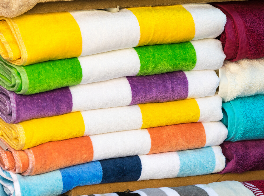 pile of clean beach towels folded neatly for summer fun