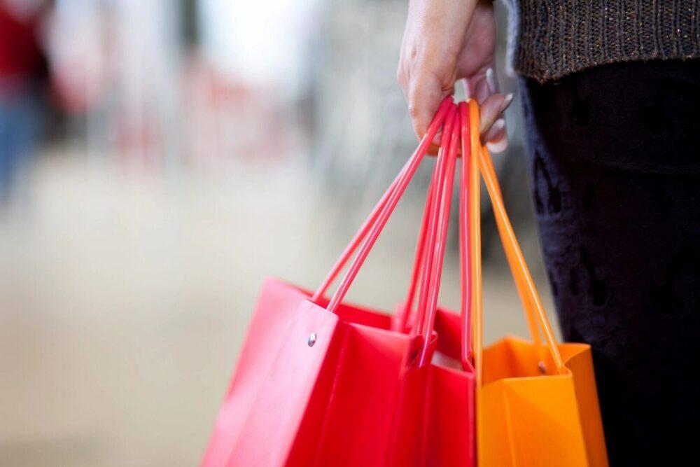Woman holding reusable shopping bags